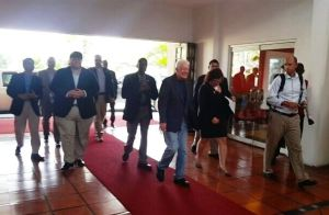 Charge d'Affaires of the United States Embassy Bryan Hunt and Former United States President Jimmy Carter arrive at the Pegasus Hotel. [iNews' Photo]