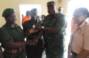 Fluencity Holder receives the keys to her new house from Chief of Staff of the GDF, Brigadier Mark Phillips.
