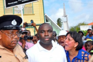 Kwame McCoy exits the polling station at St. Sidwell's Primary School. [Stabroek News' Photo]