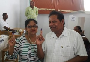 Prime Ministerial Candidate of the APNU+AFC coalition, Moses Nagamootoo and his wife, Sita Nagamootoo after casting their ballots. [iNews' Photo]