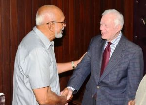 President Donald Ramotar, greeting former US President Jimmy Carter upon his arrival at the Office of the President. [Sandra Prince Photo]