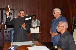 Minister of Indigenous People's Affairs Sydney Allicock takes his oath of office