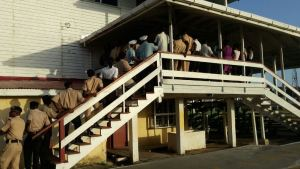 Members of the Guyana Police Force waiting their turn to vote on May 02. [iNews' Photo]