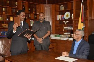 Legal Affairs Minister, Mr. Basil Williams taking the oath as Attorney General before President Granger