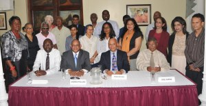 Dean Hassan (seated second from right with Andrew Pollard,  along with the representatives of the charities