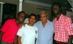 Dr. Roopnaraine flanked by members of Guyana National Youth Council