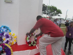 Lewis lays a wreath at the Enmore Martyrs Monument. [iNews' Photo]