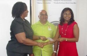 L-R GGI Vice President Violet Smith, LTI Principal Dennis Jaikarran and Cuso Country Representative Tara Persaud. [iNews' Photo]
