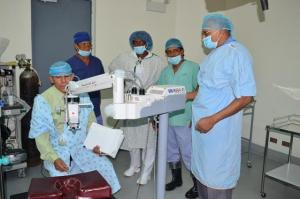 Minister of Public Health, Dr. George Norton and doctors in the theater area of the New Amsterdam Hospital, Region Six