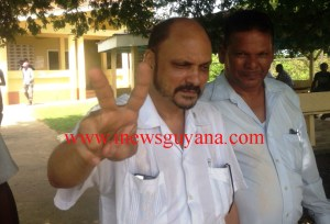 Former Health Minister, Bheri Ramsaran shows the peace sign while leaving the Whim Magistrate's Court. [iNews' Photo]