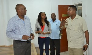Minister Harmon and other officials. [Jules Gibson Photo]