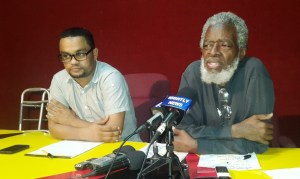 Executive member of the PPP, Dr Roger Luncheon (right).  [iNews' Photo]