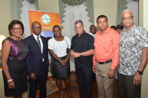 Tourism Minister Cathy Hughes with CTO's Secretary General Hugh Riley, CTO's Membership Director, Faye Gill and stakeholders of Guyana's Tourism Sector