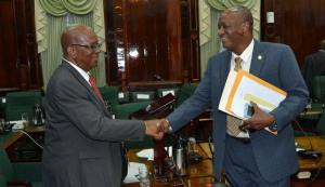 Minister of State Joseph Harmon congratulates Finance Minister Winston Jordan on presenting his first National Budget. [Jules Gibson Photo]