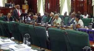 Minister of Finance, Winston Jordan presents the 2015 budget in the National Assembly. [iNews' Photo]