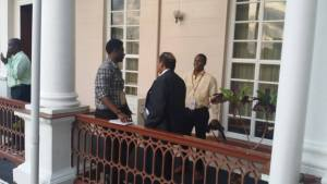 Derwayne Wills and Prime Minister Moses Nagamootoo in conversation