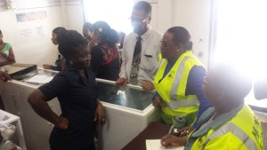 Minister Broomes interacting with employees of a Regent Street Store. [iNews' Photo]