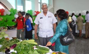 Minister Holder admires some of the products grown under the READ project