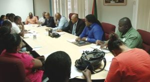 Minister Trotman during the meeting with loggers.
