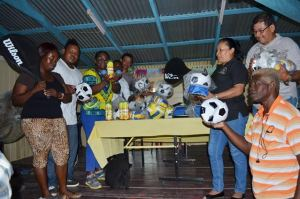 Minister of Indigenous Peoples' Affairs, Sydney Allicock; Minister within the Ministry of Social Protection, Simona Broomes, and Minister within the Ministry of Communities, Dawn Hastings- Williams handing over sports equipment to teachers of Baramita Primary School, Region One