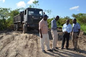 Minister within the Ministry of Communities Keith Scott and the team from the CH&PA at the site