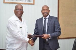 L - R: Minister of Finance Winston Jordan, CEO of CARICOM Development Fund- Rodinald Soomer.