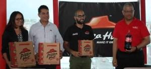 L- R: Pizza Hut Sales Manager, Pizza Hut Franchise Coach Carlos Martinez, Marketing Director Navin Singh and Banks DIH Executive Carlton Joao. [iNews' Photo]