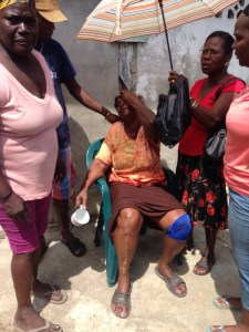 Joyce Beaton [in the chair] breaks down as her house goes up in flames. [iNews' Photo]