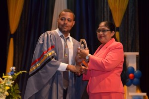 Best Overall Student Tameshwor Mohabir, collecting one of his many prizes