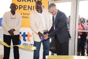 Minister of Business Dominic Gaskin along with GTT's CEO Justin Nedd cutting the ribbon to inaugurate the phone company's new store
