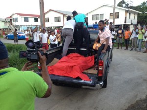 The bodies of the bandits in the back of a police vehicle. [iNews' Photo]