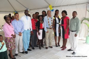 Minister of Education flanked by staff of Cummings Park Nursery and Department of Education Georgetown