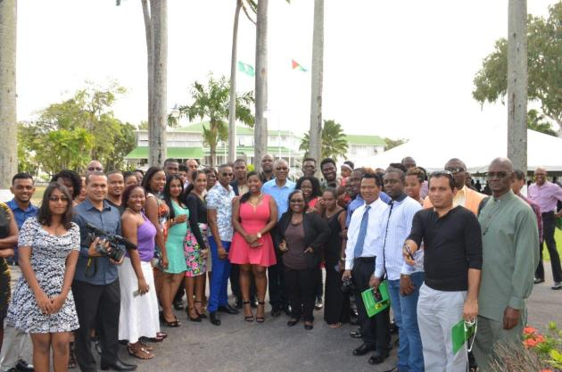 President David Granger and media workers pose for a photo op. during the Media Brunch