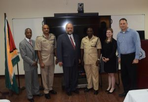 From Left to Right – U.S. Embassy INL Coordinator Leon Carr III, Guyana Police Force Commissioner Seelall Persaud, U.S. Ambassador Perry L. Holloway, Guyana Police Force Training Officer Paul Williams, MetroStar Systems Program Managers Christine Allgood, and Shai Segall.