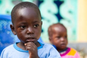 A child who lost members of his family to the Ebola virus plays at the Alliance for International Medical Action (ALIMA) Child Care Centre in Nzérékoré, Guinea. UN Photo/Martine Perret