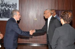 President David Granger shakes hands with Ambassador, Mr. Rafael Quintero, at his office this morning. Minister of State, Mr. Joseph Harmon is partly pictured in the background (behind the President)