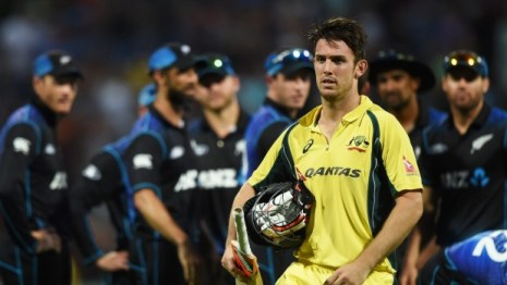 Mitchell Marsh trudges his way back to the dressing room as the Black Caps look on.
