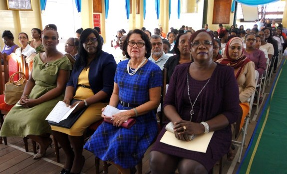 First Lady, Mrs. Sandra Granger is flanked by Minister within the Ministry of Health, Dr. Karen Cummings (left), and the Head Teacher of the Bishops' High School, Mrs. Winifred Ellis (right)