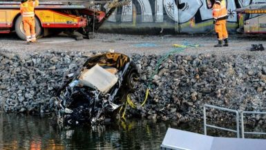 The car was towed from the canal under the E4 highway bridge near Stockholm  (AFP photo)