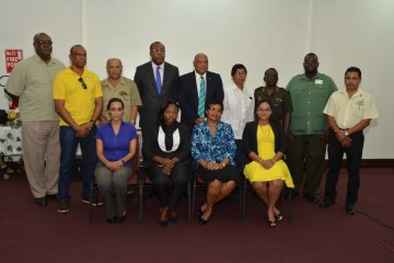 Minister of Natural Resources, Mr. Raphael Trotman (centre, standing), Chairman of the GGMC Board, Mr. Stanley Ming, (fourth from right) Acting Commissioner of GGMC, Mr. Newell Dennison, (first, left) and some of the other Board members at the installation ceremony this morning