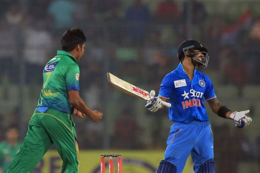 Virat Kohli reacted after being given out lbw despite getting an inside edge © AFP