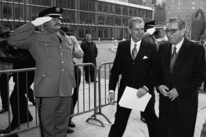 On 2 January 1992, Boutros Boutros-Ghali (right), Secretary-General of the United Nations, arrives at the Secretariat Entrance for his first working day at the United Nations. Aly Teymour, Chief of Protocol, escorts him into the building. UN Photo/John Isaac