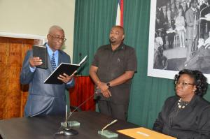 Mr. James Patterson takes the Oath of office before Chief Magistrate, Ms. Ann McLennan