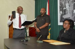 Former Director of Prisons, Mr. Dale Erskine taking his Oath as Commissioner on the Commission of Inquiry established to probe the riot at the Georgetown Prison