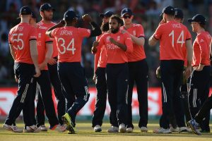 England players celebrate the fall of a wicket