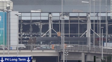 Photo shows the damaged facade of the Brussels Airport after twin blasts damage the main terminal building