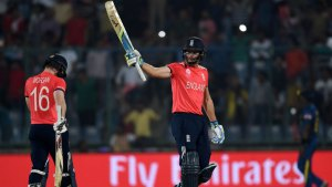 Jos Buttler's unbeaten 66 set England up for victory and a place in the semi-finals © AFP