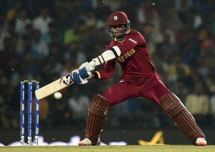 West Indies batsman Marlon Samuels plays a shot during the World T20 cricket tournament match between South Africa and West Indies at The Vidarbha Cricket Association Stadium in Nagpur on March 25, 2016. / AFP / PUNIT PARANJPE        (Photo credit should read PUNIT PARANJPE/AFP/Getty Images)