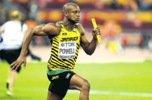 Jamaica's Asafa Powell runs his leg of the final of the men's 4x100 metres relay athletics event at the 2015 IAAF World Championships at the Bird's Nest National Stadium in Beijing on August 29, 2015.