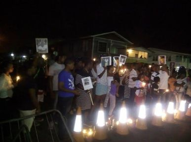 The families of the dead prisoners gathered outside of the Prison where they held the candlelight vigil